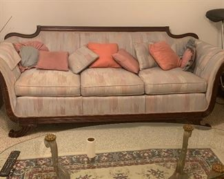 Duncan Fife sofa.                                                                               Also included... matching Duncan Fife chairs, gold and glass coffee table with matching end tables.  Accent rug.  Exercise bicycle.