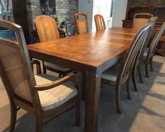 Drexel Heritage dining table with three leaves and 8 chairs with caned backs
