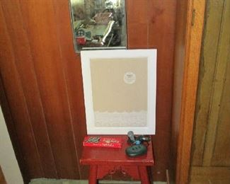 Stool, artwork and mirror
