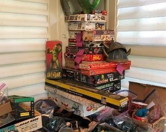 stack of vintage toys, soldiers, military vehicles, toy guns