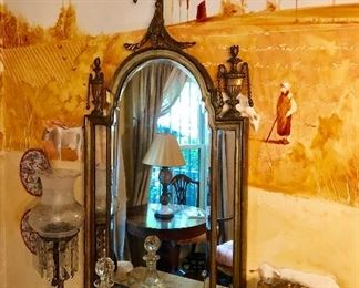 Antique Adams style gilt mirror featuring urns and pilasters