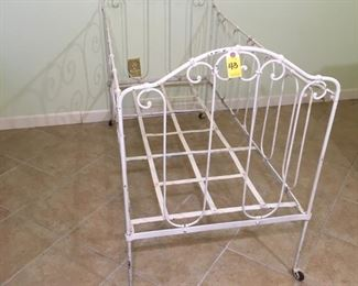 French Victorian wrought Iron folding baby bed on casters