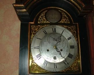 Bonnet of case clock with maker's name, Roman numerals hours and rotating day.
