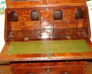 Inside cabinetry of Queen Anne secretary showing small drawers and compartments