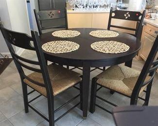4'Round Kitchen Table w/2 extensions Dark Walnut 6 Chairs Rattan Bottoms