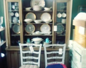 China and cabinet and chairs