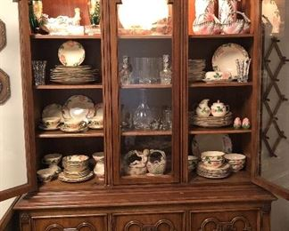"""Vintage china cabinet with """"Desert Rose"""" china & various porcelain & crystal pieces Lg wall hanging"""