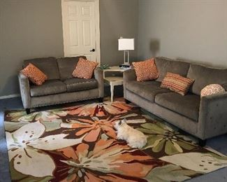 Matching sofa and love seat. Retro  corner table. Rug and lamp.