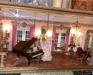 Extremely beautiful Diorama room, all furnished.  Enclosed in wood and glass; chandeliers light up.  It has an outdoor patio as well.