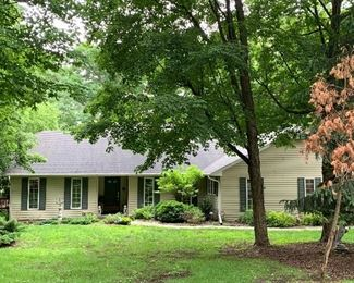 Front of house for sale: 4 BR, 2 1/2 tile Baths; Fireplace in Great Room and 4 seasons' Sun Room.  Cathedral Ceiling, Large Mudroom/Laundry Room.  Swin spa pool and hot tub-huge deck. 1 Acre, plus