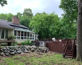 Back of house and deck- 4 BR, 2 1/2 tile Baths; Fireplace in Great Room and 4 seasons' Sun Room.  Cathedral Ceiling, Large Mudroom/Laundry Room.  Swin spa pool and hot tub-huge deck. 1 Acre, plus