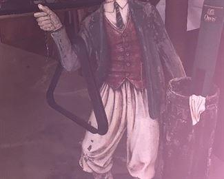 Statue of golf figure.  Holds cue sticks