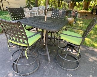 Like-New.  Sturdy, heavy wrought iron, Bar- high table, umbrella, and stand, cushions and 4 chairs-