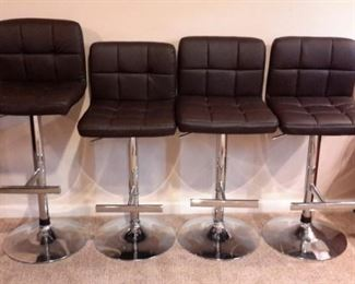 Four pleather adjustable bar stools in excellent condition!