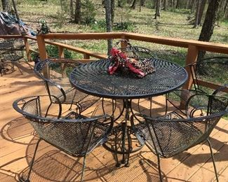 2 sets of outdoor wrought iron tables, each with 4 chairs
