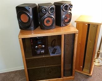 Stereo with speakers.  Oak cabinet and CD rack