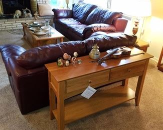 Leather sofa & loveseat by Sealy.  Oak tables