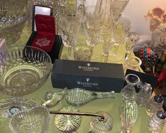 Tons of Waterford crystal! Glasses, bowls, paperweights, vases, salt and pepper shakers......