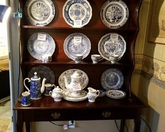 Great china cabinet display with Blue Willow, Spode plates, Blue White Tea pots