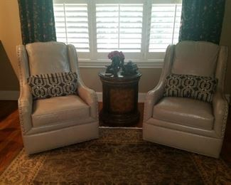 Pair of Ivory leather Nailhead Bradington Young swivel chairs