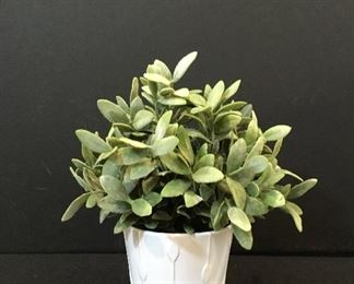 Artificial plant in planter
