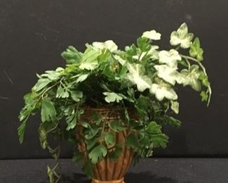 Small ceramic urn planter with artificial plant