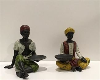 Candle holder figurines