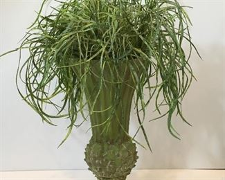 Footed vase with artificial plant