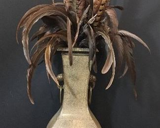 Vase with feathers