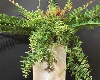 Ceramic vase with artificial plant