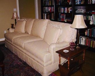 Thomasville Long creme colored brocade upholstered couch Comfortable couch in great shape.