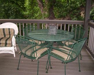 Sturdy green iron outdoor furniture- round table and 4 armchairs with coordinating cushions. Excellent shape.