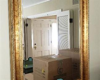 gold framed beveled mirror