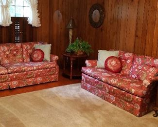 three cushion floral sofa in corals, greens, white/ two cushion love seat in same colors.  Side tables, lamp, greenery