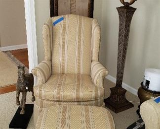 Neutral strip wing chair with ottoman, floor lamp, lighthouse print