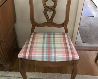One of four dining room side chairs