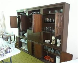 Three Piece Cabinet and a Generous Collection of Glassware and Dishes