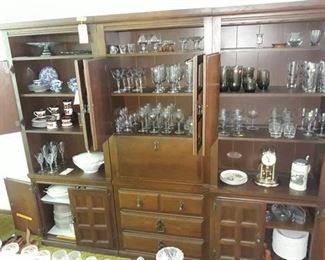Three Piece Cabinet with a Generous Collection of Glassware and Dishes