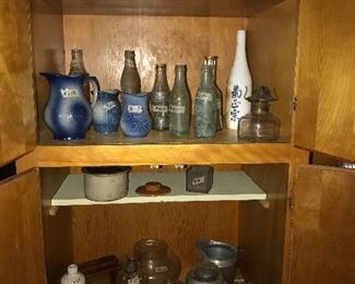 Bottles, oil lamps, stoneware, etc.