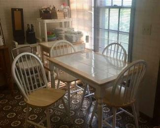 Small kitchen table with 4 chairs and a mobile island work top to match.