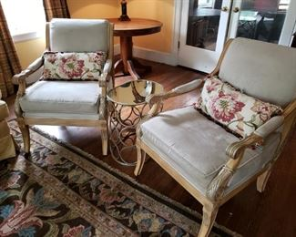 Two ornate microfiber suede chairs with decorative pillow,  Mirrored metal side table.