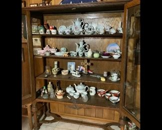 Display cabinet (also for sale) with collectibles and figurines inside.  There is another display cabinet with collectibles as well as 4-5 six foot tables covered with figurines and collectibles as well.   Just too many to show individually.  Collected both US and abroad.