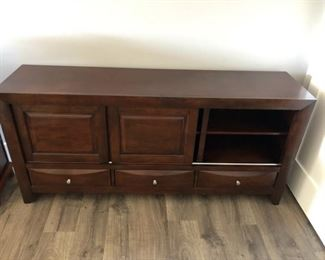 T..V. armoire with sliding cabinets for plenty of storage: $265. 3 drawers measures 68x32 . Email NapervilleEstateSales to make your appointment.