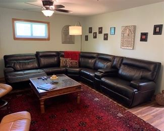 Sectional couch black mahogany leather with electrical plug-ins and electrical chairs in mint condition less than a year old