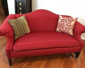 Two graceful matching loveseats with protective armcovers