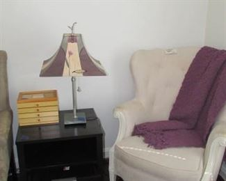 Oversized lounge chair, painted lampshade/ lamp, jewelry box, black nightstand
