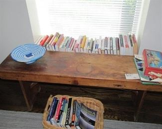 Many interesting books throughout the house, primitive bench