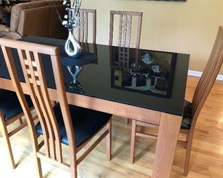 "Glass top wood dining table with 6 chairs reminiscent of Frank Lloyd Wright style chairs 72"" L 43""W"