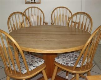 Pine table with 6 chairs and leaves to extend to an oval.