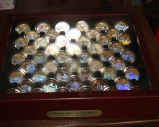 US quarter collection. Sealed coin boxes in a presentation box.